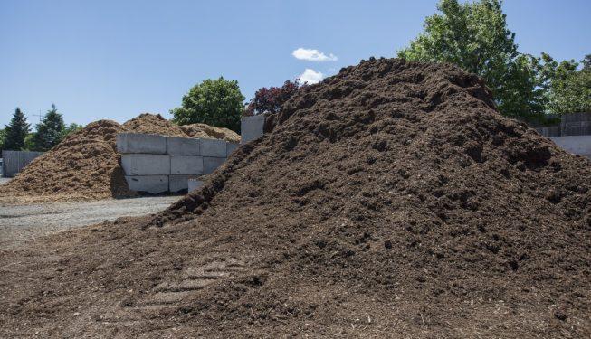 black garden mulch pile