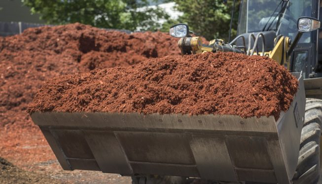 loader bucket of garden mulch